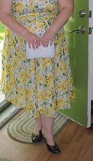 yellow retro floral dress with basket handbag